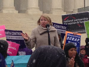 Dr. Jeanne Conry speaks at the #NotMyBossBusiness rally on the Supreme Court steps on March 25, 2014.