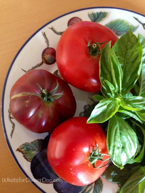 Baked tomato with pesto and mozzarella